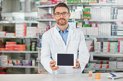 Buy stock photo Shot of a pharmacist holding up a digital tablet. All products have been altered to be void of copyright infringements