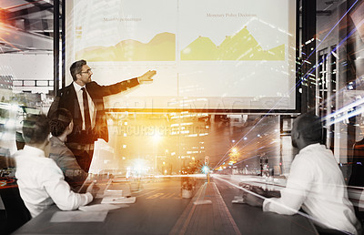 Buy stock photo Multiple exposure shot of businesspeople in a meeting superimposed on a cityscape at night