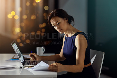 Buy stock photo Shot of a young businesswoman working late at the office