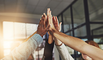 Buy stock photo Shot of a group of colleagues giving each other a high five