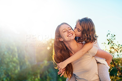 Buy stock photo Cropped shot of a young girl giving her mother a kiss on the cheek outside