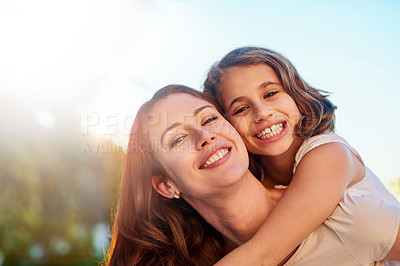 Buy stock photo Portrait of a mother giving her daughter a piggyback ride outside