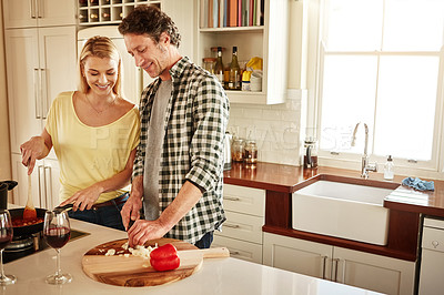 Buy stock photo Shot of a couple cooking a meal together at home
