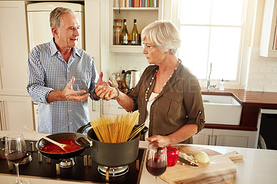 Buy stock photo Shot of a senior couple cooking a meal at home