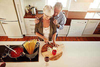 Buy stock photo Shot of a couple preparing a meal in the kitchen