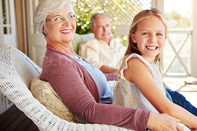 Buy stock photo Cropped portrait of a young girl sitting outside with her grandparents