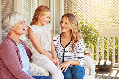 Buy stock photo Cropped shot of a young girl sitting outside with her mother and grandmother