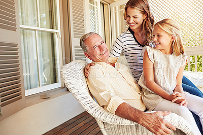 Buy stock photo Cropped shot of a young girl sitting outside with her mother and grandfather