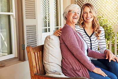 Buy stock photo Cropped portrait of a senior woman sitting outside with her adult daughter