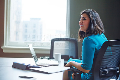 Buy stock photo Shot of a businesswoman working at her desk in an office