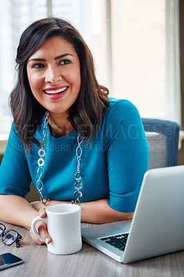 Buy stock photo Shot of a businesswoman taking a break at her desk in an office