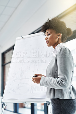 Buy stock photo Shot of a young businesswoman giving a presentation