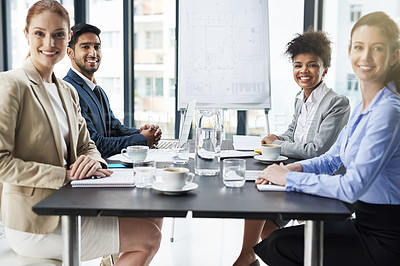 Buy stock photo Shot of a group of businesspeople seated around a table