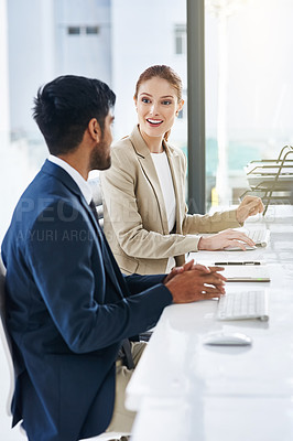 Buy stock photo Shot of two businesspeople using desktop computers