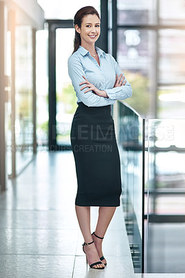 Buy stock photo Shot of a confident businesswoman at the office