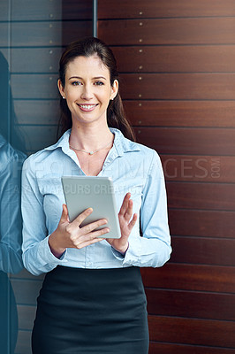 Buy stock photo Shot of a businesswoman using her digital tablet