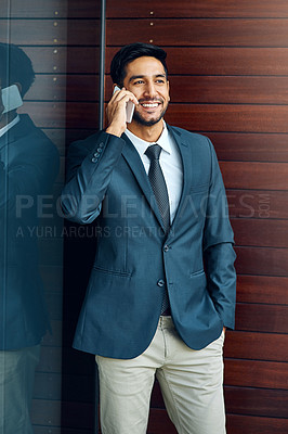 Buy stock photo Shot of a businessman taking a call outside the office
