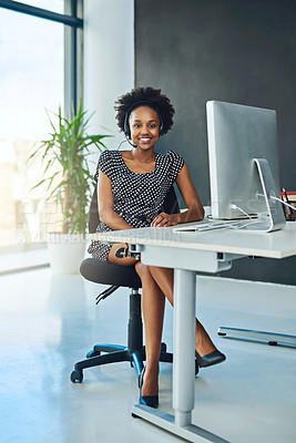 Buy stock photo Portrait of a support agent sitting at a desk in a modern office