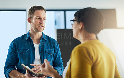 Buy stock photo Cropped shot of colleagues having a discussion in a modern office