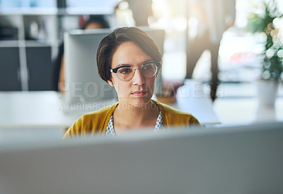 Buy stock photo Cropped shot of a young businesswoman working in a modern office