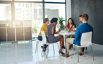 Buy stock photo Shot of a group of colleagues having an office meeting together