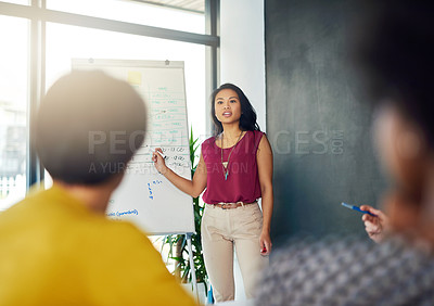 Buy stock photo Cropped shot of a businesswoman giving a presentation to her colleagues in a modern office