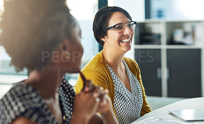 Buy stock photo Cropped shot of businesswomen having an office meeting together