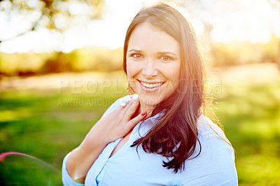 Buy stock photo Portrait of a happy woman enjoying a day outdoors