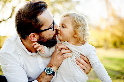 Buy stock photo Shot of a father and his young daughter bonding at the park