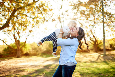 Buy stock photo Portrait of a mother and her young daughter playing together at the park
