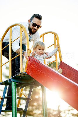 Buy stock photo Cropped shot of a father and daughter on a slide in the park