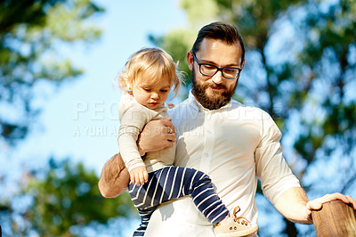 Buy stock photo Cropped shot of a father and daughter on a jungle gym in the park