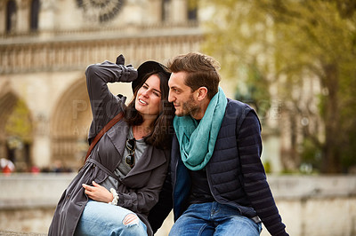 Buy stock photo Shot of a young couple enjoying the day together in the city