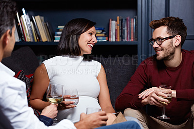 Buy stock photo Shot of a group of friends enjoying a night in together at home