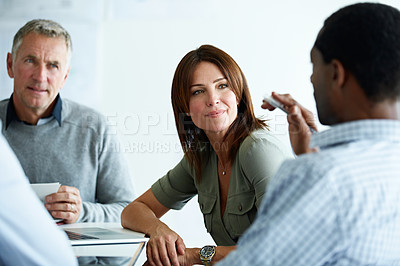 Buy stock photo Shot of a group of colleagues talking together in a modern office