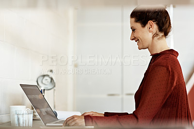 Buy stock photo Shot of a businesswoman at work on a laptop in an office