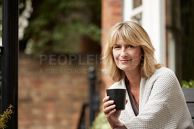 Buy stock photo Portrait of a mature woman leaning against the railing of her front porch drinking a coffee