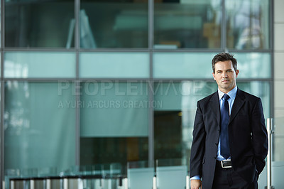 Buy stock photo Portrait of a businessman standing in the lobby of an office building