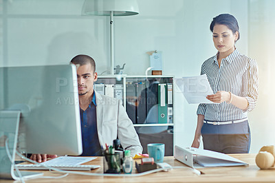 Buy stock photo Cropped shot of two businesspeople working in an office