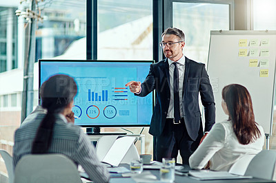 Buy stock photo Cropped shot of a businessman delivering a presentation in the boardroom