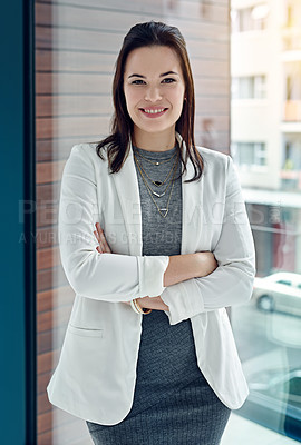 Buy stock photo Portrait of a successful businesswoman standing in their office