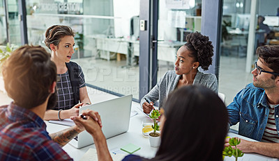 Buy stock photo Cropped shot of coworkers having a meeting in a modern office