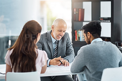 Buy stock photo Cropped shot of three businesspeople meeting in their office