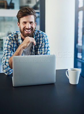 Buy stock photo Portrait of young a designer working on a laptop in a modern office