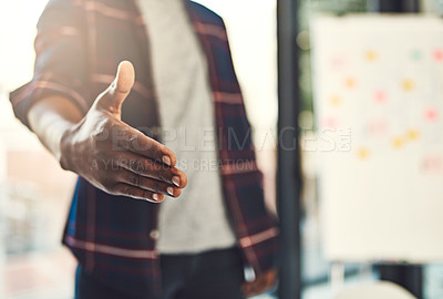 Buy stock photo Closeup shot of a young businessman gesturing for a handshake
