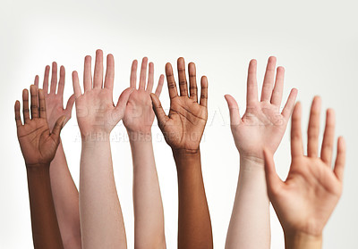 Buy stock photo Cropped shot of a group of hands reaching up together
