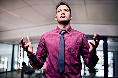Buy stock photo Cropped shot of a religious businessman standing in his office