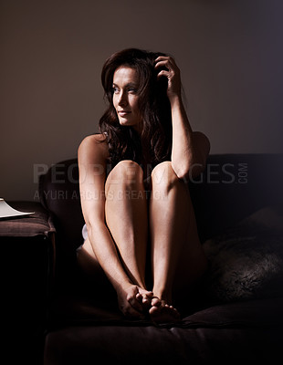 Buy stock photo Shot of a sensual woman relaxing on a sofa at home