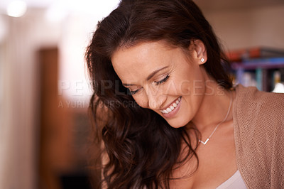 Buy stock photo Shot of a beautiful woman relaxing at home
