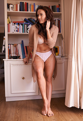 Buy stock photo Full length shot of an attractive young woman standing in her underwear at home